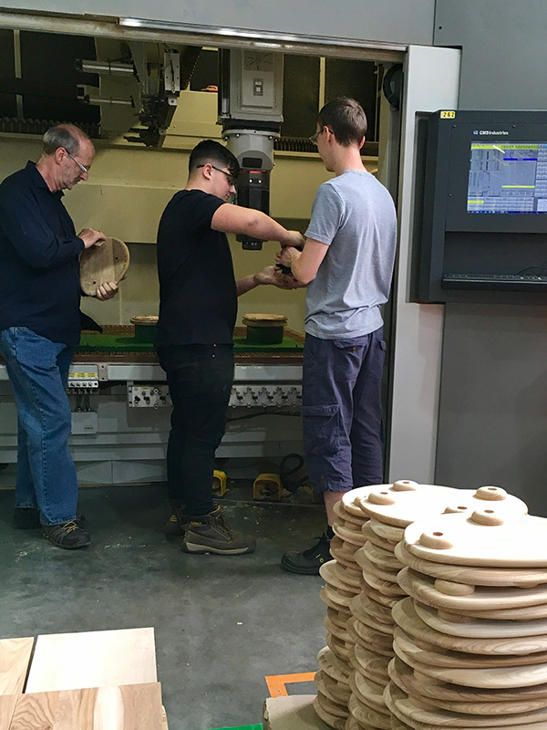 Roy working with 2 of our apprentices on the CNC's