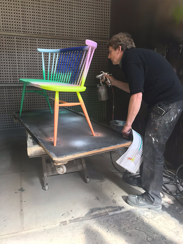 Graeme hand spraying the love seats