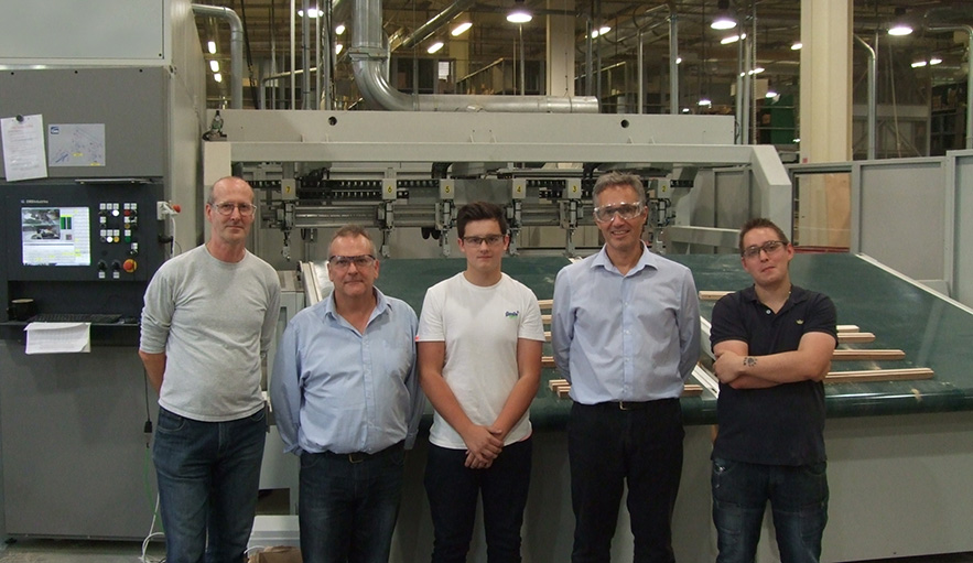 New apprentices with our production director and factory managers infront of the new 5-axis CNC machine